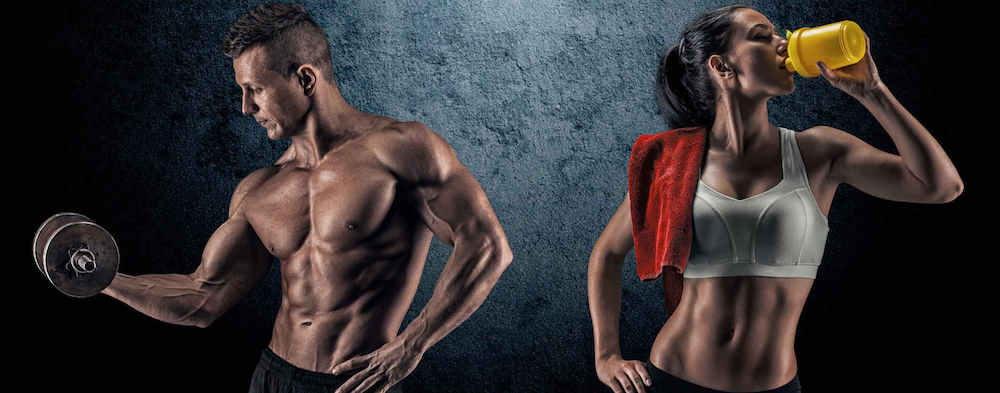 Bodybuilding. Strong man and a woman posing on a dark background