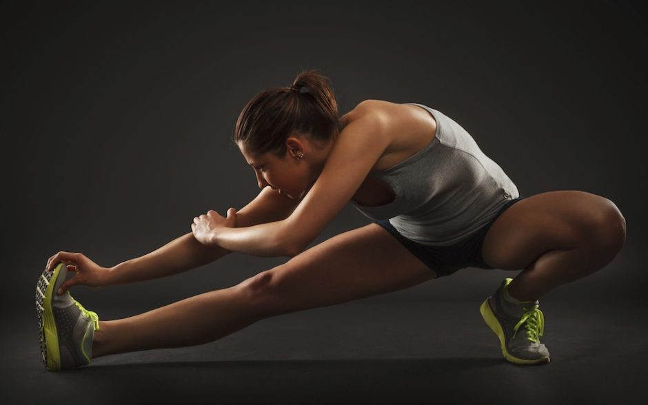 young-woman-stretching-hamstring-legs-exercise-training-fitness